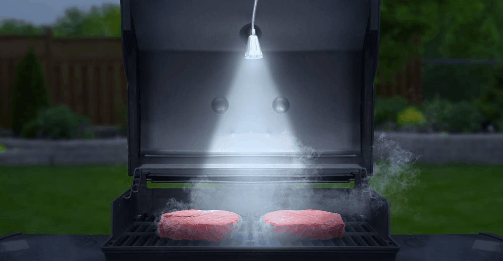 a grill light iluminating beef